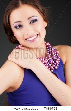 Woman In Purple Dress With Beads