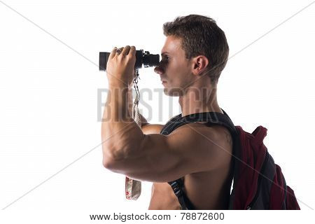 Shirtless Muscular Young Man With Binocular And Backpack