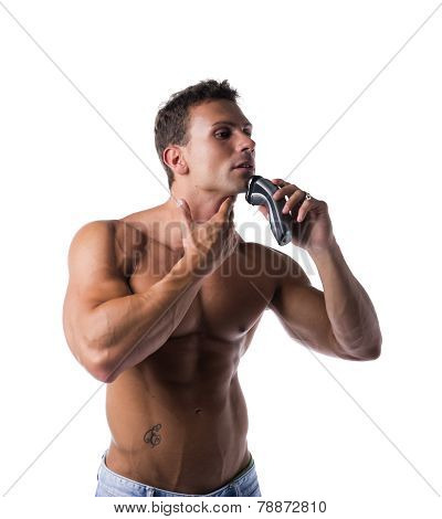 Muscular Man Shirtless Using Electric Shaver, Looking To A Side