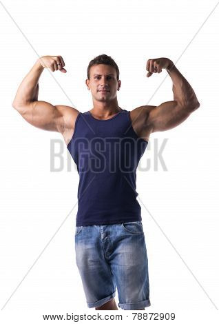 Attractive Muscular Man Striking A Pose, Showing Biceps