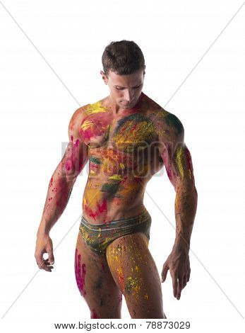 Muscular Young Man Shirtless With Skin Painted With Holi Colors