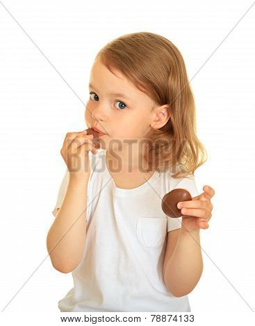little girl eating chocolate.