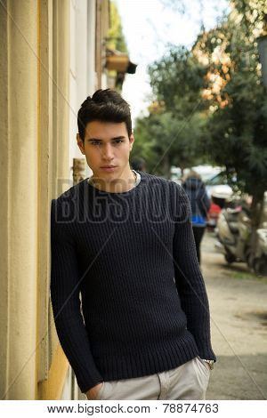 Handsome Young Man Standing In European City Street