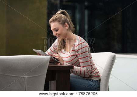 Happy Woman Student In Cafe With Touch Pad