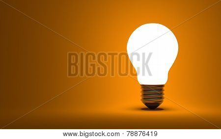 Shining Arbitrary Light Bulb On Orange