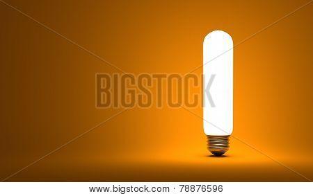 Shining Tubular Light Bulb On Orange