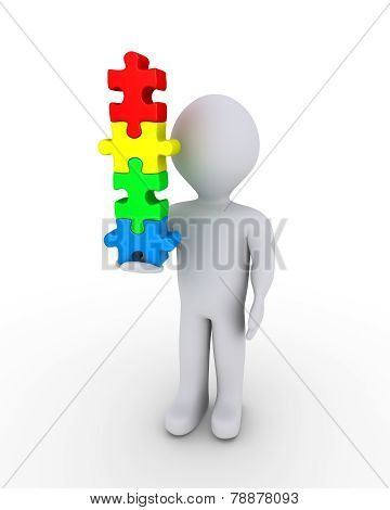 Person Balancing Puzzle Pieces