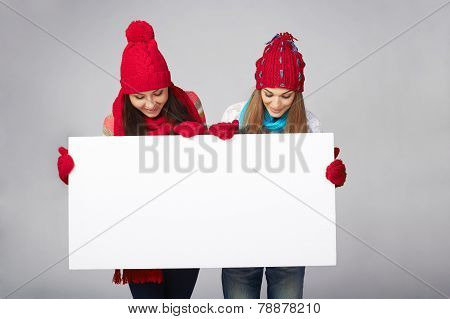 Two winter females with banner