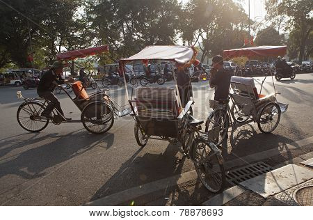 Life in Vietnam - cyclo driver waiting for customers