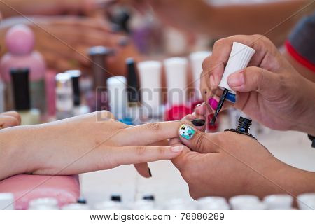 Woman Paints Her Nails Painted