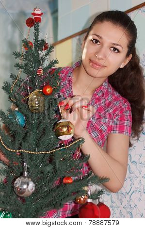 Brunette Girl Decorating Christmas Tree