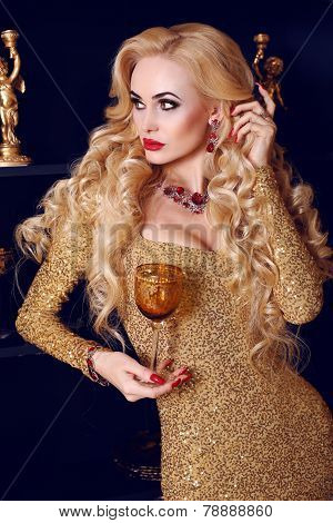 Beautiful Woman With Blond Hair In Luxurious Golden Dress