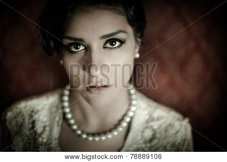 Gorgeous brunette woman vintage portrait in old house