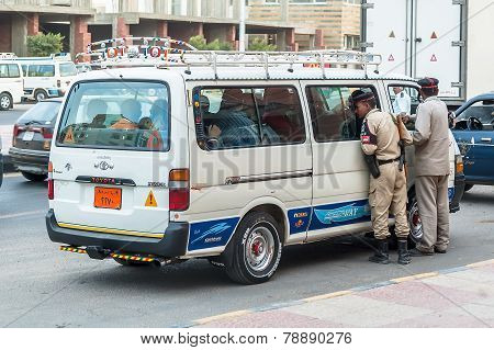 Egyptian Police Officers check vehicle