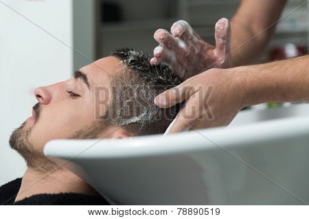 Smiling Man Having His Hair Washed At Hairdresser's