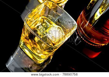 Top Of View Of Whiskey With Ice In Glass On Black Background