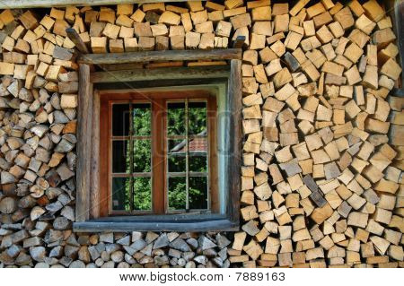 Stack Of Firewood With Window