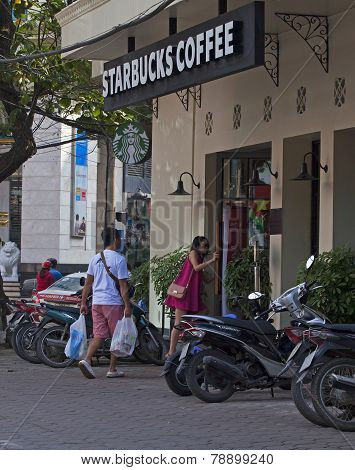 Customer entering a coffee shop of Starbucks in Hanoi capital