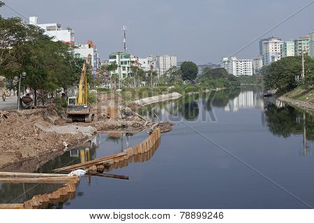 Construction site on a polluted river in a urban area in Hanoi capital