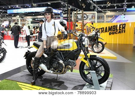 Bangkok - November 28: Ducati Scrambler Motorcycle With Unidentified Model  On Display At The Motor