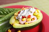 image of avocado  - Tasty salad in avocado on plate table close - JPG