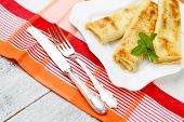 stock photo of crepes  - Tasty crepes on wooden table studio shot - JPG