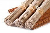 stock photo of buckwheat  - Three bunch raw buckwheat soba noodles close up isolated on white background - JPG