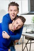 picture of piggyback ride  - Friendly brothers twins having fun riding piggyback in the white home or restaurant interior - JPG