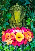 picture of ganesh  - Ganesh stone statue with hibiscus flowers - JPG