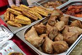 stock photo of samosa  - Indian appetizer samosa on the platter at a market - JPG