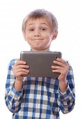 image of hairline  - Boy with tablet - JPG
