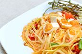 picture of green papaya salad  - Close up of green papaya salad with salted egg Thai food - JPG