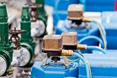 foto of pipeline  - detail of oil pipeline with valves in large oil refinery