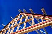 pic of residential home  - New residential construction home framing against a blue sky - JPG