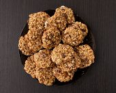 stock photo of baked raisin cookies  - oatmeal cookies with raisins on a plate on table - JPG