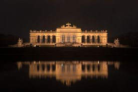 image of schoenbrunn  - Gloriette in Schoenbrunn Palace Gardens Vienna Austria at night as it reflects in the water - JPG