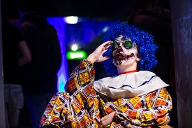 pic of clowns  - Crazy ugly grunge evil clown in town on Halloween making people shock and scared - JPG