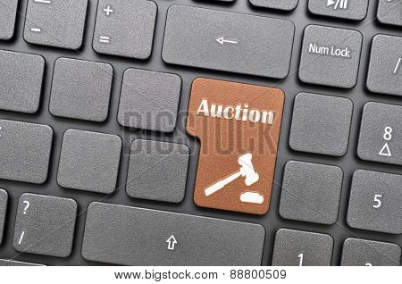 Brown auction key on keyboard