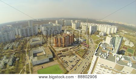 Buildings of a large residential area in the spring day, aerial view