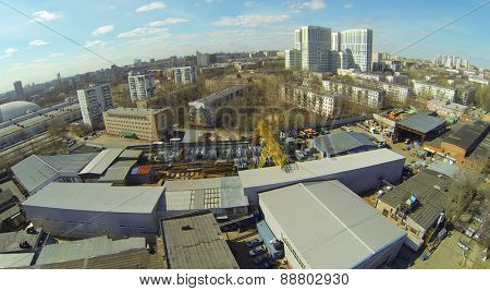 Cityscape with the factory premises and residential buildings, aerial view
