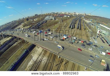 Urban landscape with many railroad tracks and overpass, aerial view