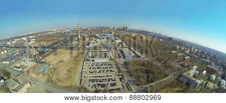 The territory of oil processing plant near the city on a sunny spring day, aerial view
