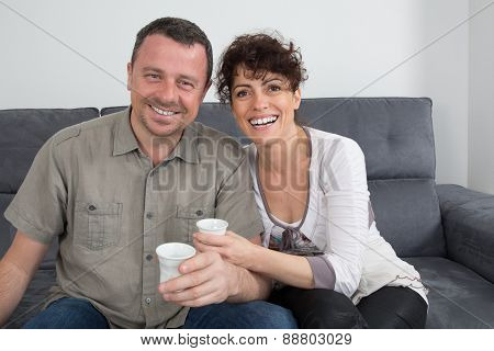 Happy And Lovely Couple Drinking Coffee At Home