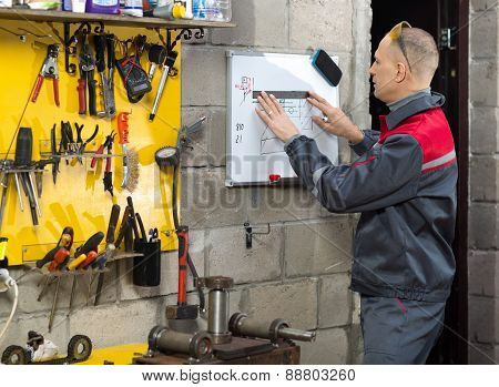 Mechanic worker studying his instructions