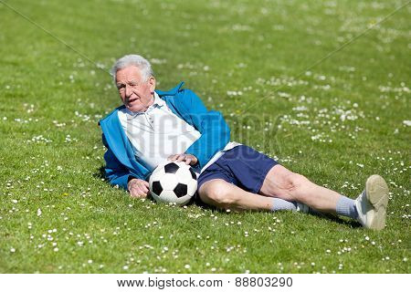 Senior Footbal Player On Grass