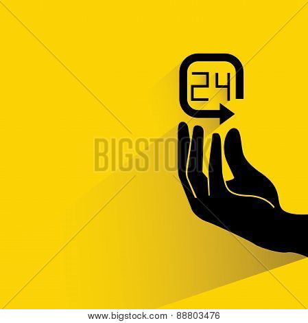 hand holding 24 hour service symbol