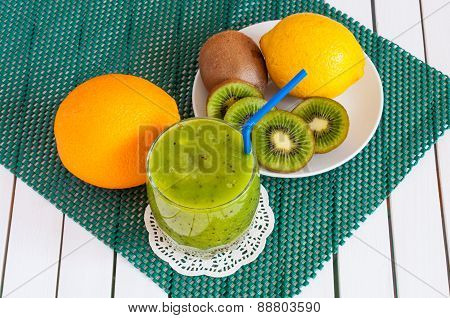 Delicious array of fresh fruit juices served in tall glass made from liquidised kiwifruit and orange