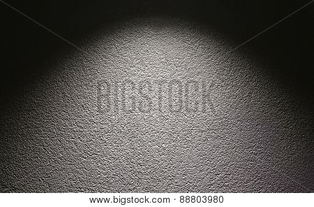 Background of a concrete wall and light spot.