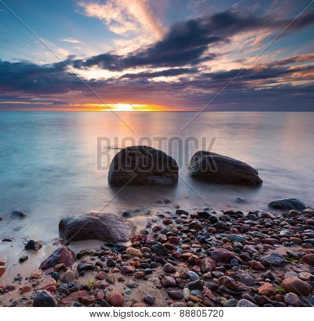 Beautiful Rocky Sea Shore At Sunrise Or Sunset.