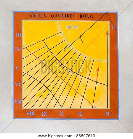 Ancient sundial of Northern Italy with latin inscription, yellow, squared